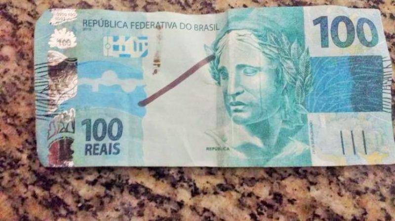 Rapaz paga entregador de lanche com nota falsa, mas é reconhecido por foto no WhatsApp
